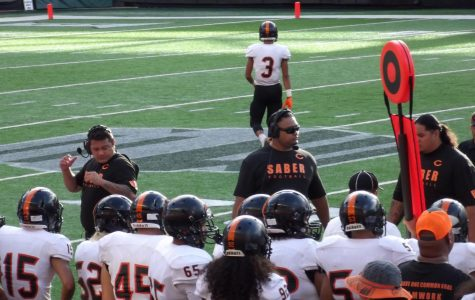 Campbell coaches briefing the team during half-time. Photo by Makena Pauly.