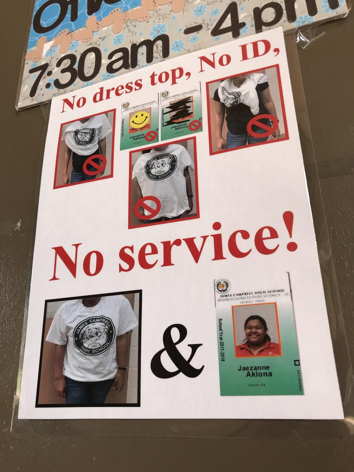 Dress-top enforcement sign at JCHS's office building. Photo by Keona Blanks.