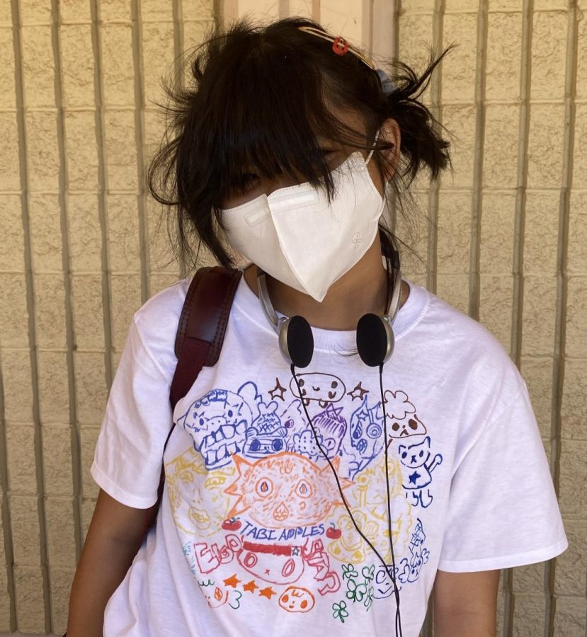 Jessica Macaspac, 12, creates shirts made to order. She found peace in making shirts for others.